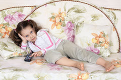The girl on a sofa Royalty Free Stock Photos
