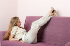 Girl on a sofa Royalty Free Stock Photography