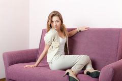 Girl on a sofa Royalty Free Stock Photo