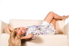 Girl at sofa Royalty Free Stock Photo
