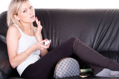 Girl on a sofa Royalty Free Stock Photos