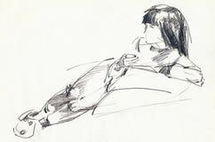 Girl on the sofa Stock Image