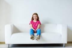 Girl on sofa Royalty Free Stock Image