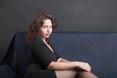Girl on sofa Stock Photography