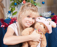 The girl with a soft toy Stock Photography