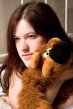 Girl with soft toy Royalty Free Stock Photo