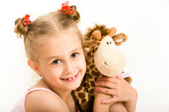 Girl with soft toy royalty free stock image