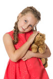 Girl with soft toy Stock Image