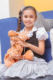 Girl with a soft toy Stock Photo