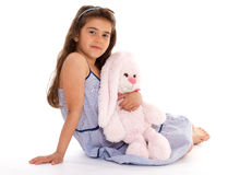 Girl with a soft toy Stock Image