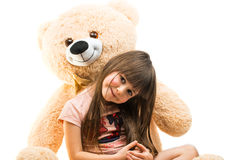 the girl with a soft toy  Stock Images