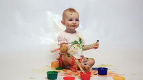 Girl soiled by multi-colored paints stock video footage