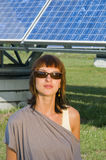 Girl by the solar cells Stock Images