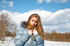 Girl in the solar winter afternoon in park Stock Image