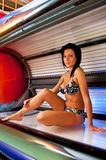 Girl in solarium Stock Images