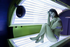 Girl is in a solarium Stock Image