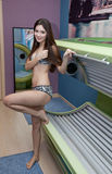 Girl is in a solarium. Young woman is tanning in solarium Stock Photography