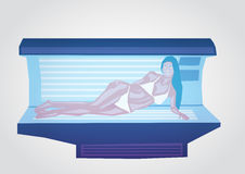 Girl and solarium Stock Photos