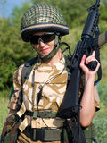 Girl soldier. British girl soldier in desert uniform holding her rifle royalty free stock photos