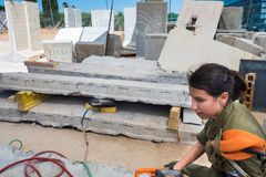 Girl soldier from IDF Search and Rescue unit. HOLON, ISRAEL - SEPTEMBER 28, 2018: Girl soldier from IDF Search and Rescue unit show working with air lifting bag stock photos