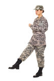 Girl - soldier in the military uniform. Young girl-soldier in the camouflage military uniform and hat marches to somewhere Stock Image