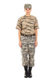 Girl - soldier in the military uniform. Young girl-soldier in the camouflage military uniform and hat standing by the front Stock Photography