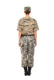 Girl - soldier in the military uniform. Young girl-soldier in the camouflage military uniform and hat, view from the back Royalty Free Stock Images