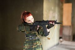 Girl soldier in uniform. The girl in the black beret. Camouflage t-shirt on the girl. Female face war stock photo