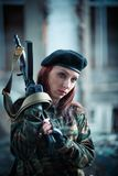 Girl soldier in uniform. The girl in the black beret. Camouflage t-shirt on the girl. Female face war royalty free stock images