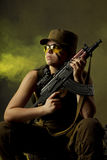 Girl soldiers in the smoke Stock Image