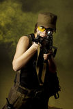 Girl soldiers in the smoke Stock Photo