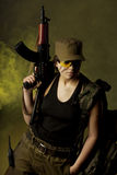 Girl soldiers in the smoke Royalty Free Stock Images