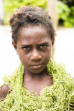 Thoughtful Girl Solomon Islands. Portrait of girl costumed with natural material dress Stock Photos