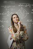 Girl solving equation Royalty Free Stock Photos