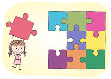 Girl solving puzzle Stock Photos