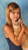Girl with somali kitten. Beautiful girl seven years old in swimsuit with somali kitten fawn color portrait looking at camera Stock Images