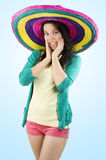 The girl with sombrero. Young and pretty brunette woman with colored dress and a big hat full colored royalty free stock image