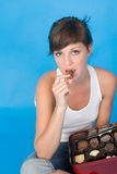 Girl with some sweets. A girl with some sweets Stock Photo
