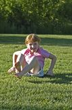 Girl after somersault at park. Redheaded girl just completed a somersault in a park Stock Images