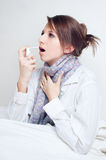 Girl with a sore throat. Splatter spray Stock Images