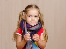Girl with a sore throat in warm scarf Royalty Free Stock Photos