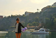 Girl in Sorrento. Picture of a girl with Sorrento's coast landscape at the back Stock Photography