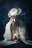 The girl in sorrow. Beautiful sad girl with a wreath on his head Stock Photo