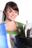 Girl sorting her garbage Stock Photo