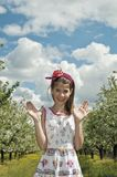 Girl in the sour cherry orchard happy Royalty Free Stock Image