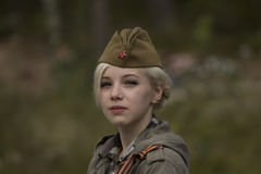 Girl in Soviet Forage Cap Stock Photography