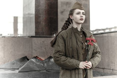 Girl in a Soviet military uniform Royalty Free Stock Photography