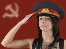 The girl on the Soviet symbols background Stock Images
