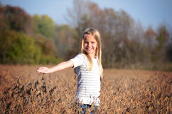 Girl in soybean field Royalty Free Stock Images