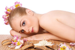 Girl in spa. Beautiful slim young blond girl in spa, on white background Royalty Free Stock Images